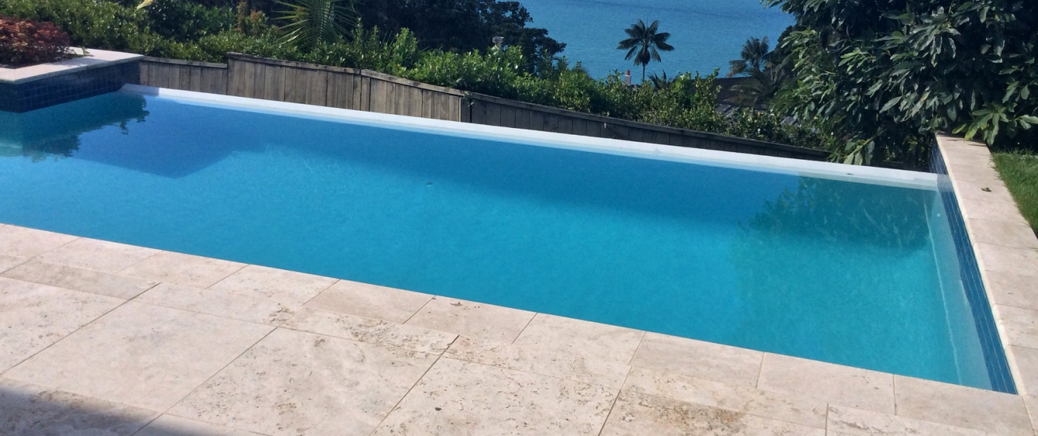 image of a pool with an ocean view in the background